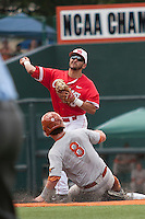 Houston Cougars second baseman Josh Vidales (8) turns a double play as Texas Longhorns base runner Brooks Marlow (8) slides into second base during the NCAA baseball game on June 6, 2014 at UFCU Disch–Falk Field in Austin, Texas. The Longhorns defeated the Cougars 4-2 in Game 1 of the NCAA Super Regional. (Andrew Woolley/Four Seam Images)