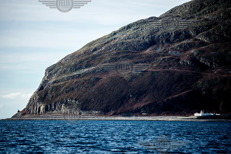 Ailsa Craig, an unihabited volcanic island that is the source of the granite used to make most of the world's curling stones, including those used every four years in the Winter Olympics. The island's lighthouse is on the right and at the far left a 19th Century gas-powered fog horn. The island is for sale with an asking price of GBP 1.6 million.
