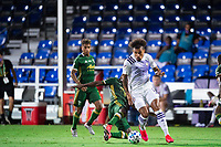 LAKE BUENA VISTA, FL - AUGUST 11: Junior Urso #11 of Orlando City SC dribbles the ball during a game between Orlando City SC and Portland Timbers at ESPN Wide World of Sports on August 11, 2020 in Lake Buena Vista, Florida.