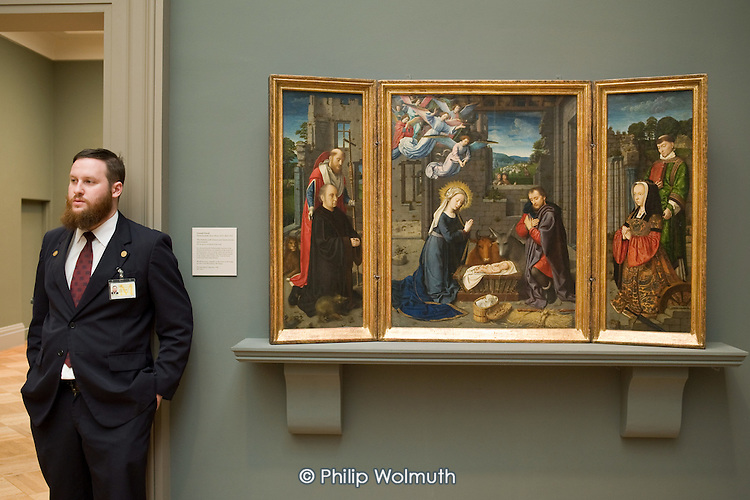 Gallery attendant and Nativity painting (1455) by Gerard David, Metropolitan Museum of Art, Manhattan, New York.