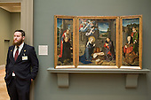 Gallery attendant and Nativity painting (1455) by Gerard David, Metropolitan Museum of Art, Manhattan, New York.