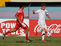 Andrew Oliver (16) of the USA brings the ball upfield during the group stage of the CONCACAF Men's Under 17 Championship at Jarrett Park in Montego Bay, Jamaica. The USA defeated Panama, 1-0.