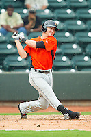 Nicky Delmonico (26) of the Frederick Keys follows through on his swing against the Winston-Salem Dash at BB&T Ballpark on July 21, 2013 in Winston-Salem, North Carolina.  The Dash defeated the Keys 3-2.  (Brian Westerholt/Four Seam Images)