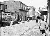 "0710-128. Absinthe House with ""Budweiser Everywhere"" billboard sign. summer 1911. New Orleans, E.B. Thompson."