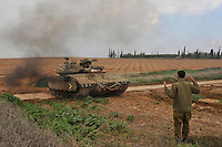 An Israeli tank arrives at the Israel-Gaza border. Israeli forces began an air offensive against Hamas in Gaza on 27/12/2008, which quickly escalated into an offensive by land, sea and air, in retaliation against Palestinian rockets fired into Israel. After eight days of bombardment, leaving over 400 Palestinians and four Israelis dead, Israeli tanks entered Gaza on 04/01/2009...