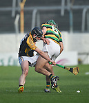 Patjoe Connolly of Ballyea in action against Brian Moylan of Glen Rovers during their Munster Club hurling final at Thurles. Photograph by John Kelly.