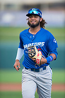 Ogden Raptors shortstop Ronny Brito (5) jogs off the field between innings of a Pioneer League game against the Orem Owlz at Home of the OWLZ on August 24, 2018 in Orem, Utah. The Ogden Raptors defeated the Orem Owlz by a score of 13-5. (Zachary Lucy/Four Seam Images)