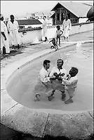 A Protestant baptism.  With the major religions in the former Yugoslavia being Orthodox Christian, Catholic Christian and Islam, different religions and other branches of Christianity are labeled as religious cults. Skopje, Macedonia, June 2001 © Stephen Blake Farrington<br />
