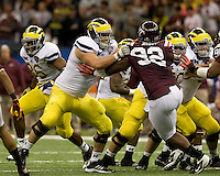 Mark Huyge of Michigan in action during Sugar Bowl game against Virginia Tech at Mercedes-Benz SuperDome in New Orleans, Louisiana on January 3rd, 2012.  Michigan defeated Virginia Tech, 23-20 in first overtime.