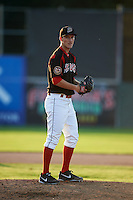 Batavia Muckdogs pitcher Justin Langley (19) delivers a pitch during the second game of a doubleheader against the Mahoning Valley Scrappers on July 2, 2015 at Dwyer Stadium in Batavia, New York.  Mahoning Valley defeated Batavia 3-0.  (Mike Janes/Four Seam Images)