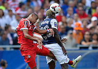 Chicago, IL - Sunday July 28, 2013:   USMNT forward Eddie Johnson (26) heads a ball during the CONCACAF Gold Cup Finals soccer match between the USMNT and Panama, at Soldier Field in Chicago, IL.