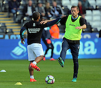 (L-R) Wayne Routledge and Gylfi Sigurdsson of Swansea City wearing Show Racism Red Card before the Premier League match between Swansea City and Watford at The Liberty Stadium on October 22, 2016 in Swansea, Wales, UK.