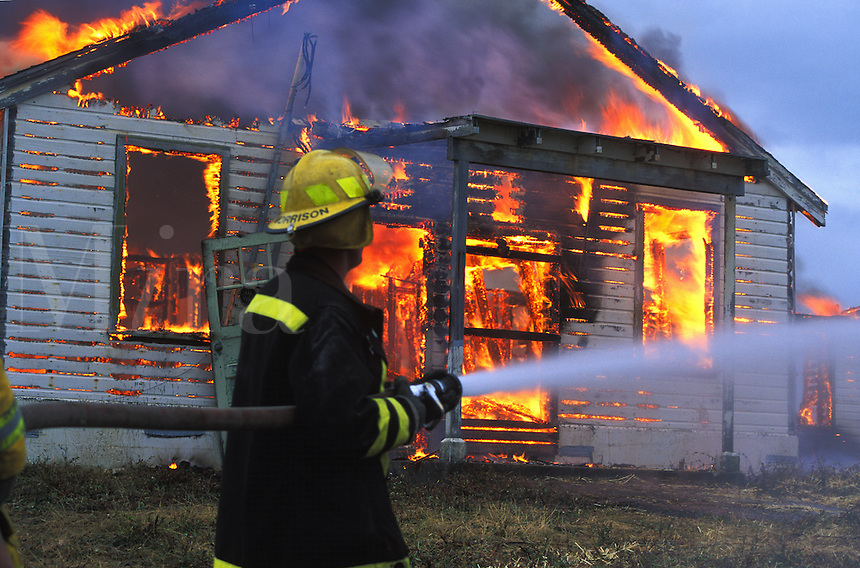 fireman fights fire at burning home