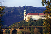 Usti nad Labem, Czech Republic. Decin Castle, above the confluence of the Ploucnice with the Elbe rivers; home of the Thun-Hohenstein family. Architect Jan Vaclav Kosch. With railway bridge in front.