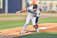 Augusta GreenJackets third baseman Jacob Gonzalez (18) attempts to field a bunt during a game against the Asheville Tourists at McCormick Field on April 6, 2019 in Asheville, North Carolina. The Tourists defeated the GreenJackets 6-3. (Tony Farlow/Four Seam Images)