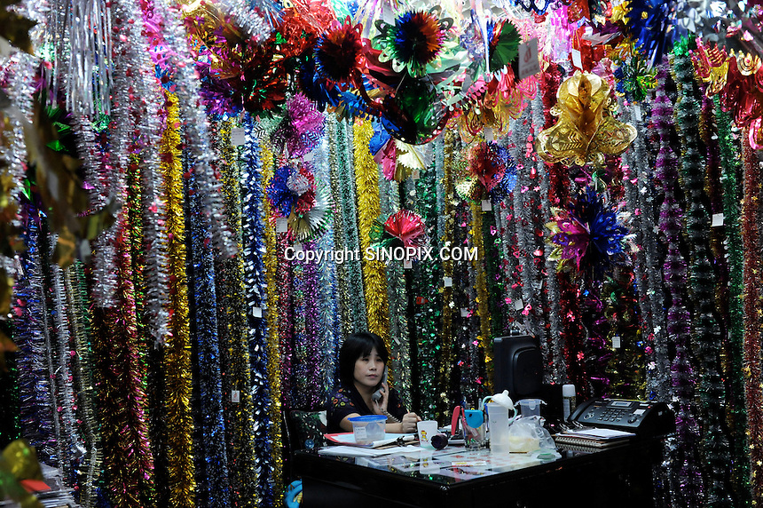 Christmas decorations and ornaments for sale in YiWu Samll Commodity Wholesale Market, Yi Wu, China.  Yi Wu exports 40-50 % of the entire European Christmas decorations and 70 % of US and Mexico's Christmas gifts come from Yi Wu, the world's largest whole-sale market.