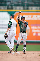 Great Lakes Loons left fielder Ariel Sandoval (15) signals to the dugout behind Brad Zunica (35) during the second game of a doubleheader against the Fort Wayne TinCaps on May 11, 2016 at Parkview Field in Fort Wayne, Indiana.  Great Lakes defeated Fort Wayne 5-0.  (Mike Janes/Four Seam Images)