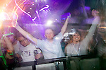 Music fans listening to the Judge Jules set in the Gods Kitchen tent at the annual Escape into the Park dance festival in Singleton Park, Swansea..
