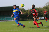 Dexter Peter of Coggeshall and Nick Reynolds of Romford during Romford vs Coggeshall Town, Bostik League Division 1 North Football at Rookery Hill on 13th October 2018