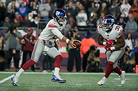 FOXBORO, MA - OCTOBER 10: New York Giants Quarterback Daniel Jones (8) fakes a handoff to New York Giants Runningback Elijhaa Penny (39) during a game between New York Giants and New England Patriots at Gillettes on October 10, 2019 in Foxboro, Massachusetts.