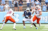 CHAPEL HILL, NC - OCTOBER 10: Javonte Williams #25 of North Carolina cuts back against Jermaine Waller #28 of Virginia Tech on a 29-yard run during a game between Virginia Tech and North Carolina at Kenan Memorial Stadium on October 10, 2020 in Chapel Hill, North Carolina.