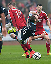 Dundee's Kevin Thomson is caught late by Aberdeen's David Goodwillie.