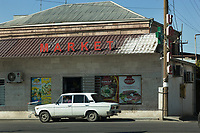 Armenia. Ararat Province. Byuravan. A white Lada car is parked in front of the market grocery store. Byuravan is a village located in the Ararat Province. Lada is a brand of cars manufactured by AvtoVAZ, a Russian company. The Lada brand appeared in 1973.1.10.2019 © 2019 Didier Ruef