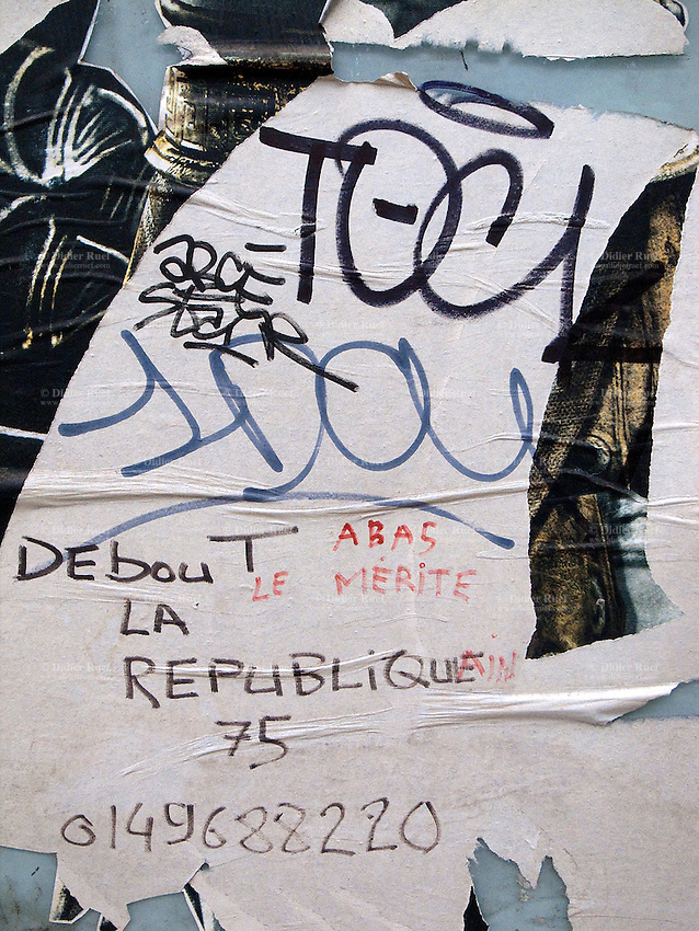 France. Paris. Torn posters on the subway's walls. Graffitti. An unknwon person has writen a local phone number and the words: Down with merit. Stand up for the Republic. The Republic is a form of government in which the people or some portion thereof retain supreme control over the government, and in which the head of government is not a monarch.17.11.10  © 2010 Didier Ruef