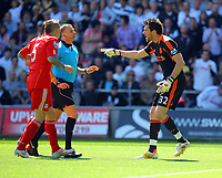 FAO SPORTS PICTURE DESK<br /> Pictured: Liverpool goalkeeper Alexander Doni  protesting to the referee M Halsey (in blue) for a foul to Danny Graham of Swansea . Sunday, 13 May 2012<br /> Re: Premier League football, Swansea City FC v Liverpool FC at the Liberty Stadium, south Wales.