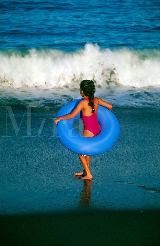 Young girl playing in the syurf, Cape Cod, MA
