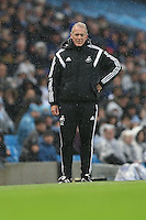 Swansea City Manager Alan Curtis looks on during the Barclays Premier League Match between Manchester City and Swansea City played at the Etihad Stadium, Manchester on 12th December 2015