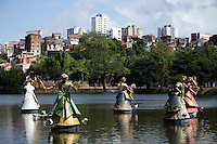 Colour shot of sculptures in a lake over looking Salvador