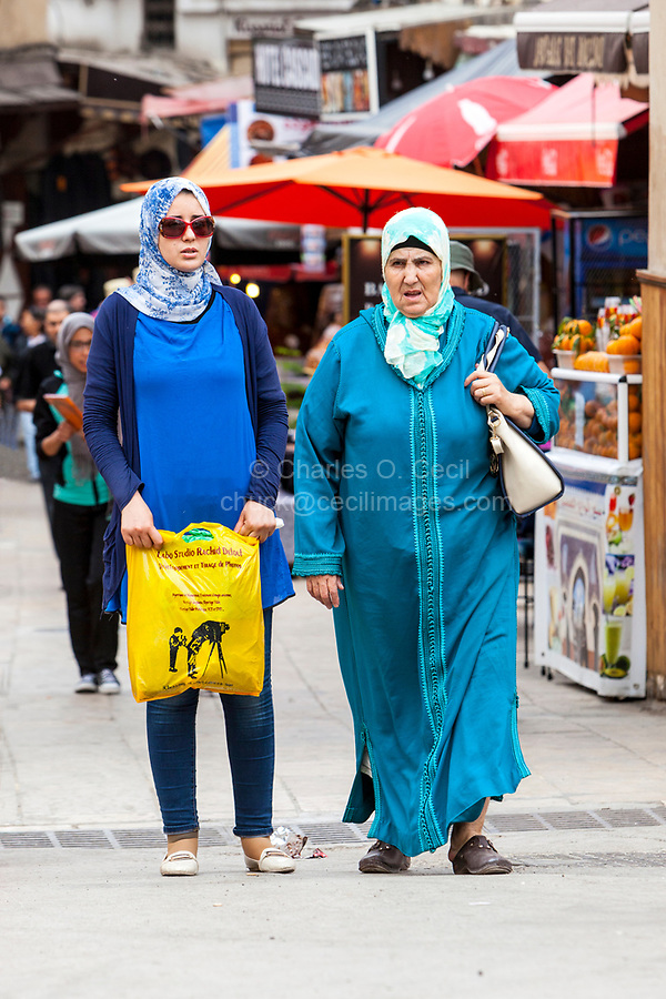 Fes, Morocco.  Juxtaposition of Modern and Traditional Dress Styles, Fes El-Bali.