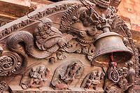 Nepal, Patan.  Hindu Temple Bell and Wood Carvings.