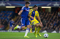 Diego Costa of Chelsea & Eitan Tibi of Maccabi Tel Aviv battle for the ball during the UEFA Champions League match between Chelsea and Maccabi Tel Aviv at Stamford Bridge, London, England on 16 September 2015. Photo by Andy Rowland.