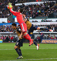 Swansea City goalkeeper Lukasz Fabianski fumbles the ball to allow Laurent Koscielny of Arsenal to score a goal to make the score 0-2 during the Barclays Premier League match between Swansea City and Arsenal played at The Liberty Stadium, Swansea on October 31st 2015