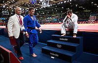 29 JUL 2012 - LONDON, GBR - Tarlan Karimov (AZE) (right) of Azerbaijan watches as the winner of their men's -66kg category repechage contest, Pawel Zagrodnik (POL) (centre) of Poland walks from the mat during the London 2012 Olympic Games judo at the ExCel Exhibition Centre in London, Great Britain .(PHOTO (C) 2012 NIGEL FARROW)