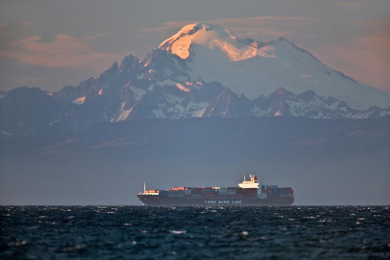 Cargo ship with Mt. Baker. Washington.