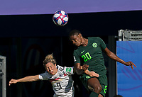 GRENOBLE, FRANCE - JUNE 22: Svenja Huth #9 of the German National Team, Chidinma Okeke #20 of the Nigerian National Team battle for head ball during a game between Nigeria and Germany at Stade des Alpes on June 22, 2019 in Grenoble, France.