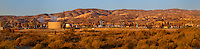 906500007 panorama oil derricks and storage tanks in a working oil field in southern kern county california