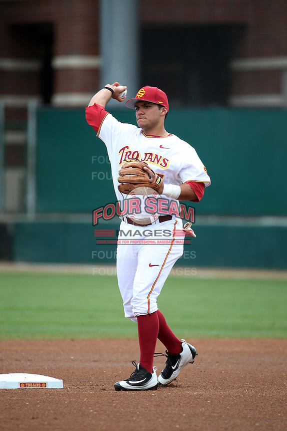 Frankie Rios (17) of the Southern California Trojans makes a throw during a game against the Mississippi State Bulldogs at Dedeaux Field on March 5, 2016 in Los Angeles, California. Mississippi State defeated Southern California , 8-7. (Larry Goren/Four Seam Images)