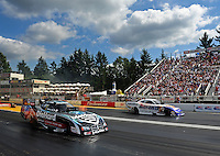 Aug. 7, 2011; Kent, WA, USA; NHRA funny car driver Matt Hagan (near lane) races against Jack Beckman during the Northwest Nationals at Pacific Raceways. Mandatory Credit: Mark J. Rebilas-