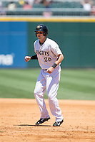 Tyler Colvin (26) of the Charlotte Knights takes his lead off of first base against the Indianapolis Indians at BB&T BallPark on June 21, 2015 in Charlotte, North Carolina.  The Knights defeated the Indians 13-1.  (Brian Westerholt/Four Seam Images)