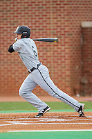 Connor Owings (6) of the Coastal Carolina Chanticleers follows through on his swing against the High Point Panthers at Willard Stadium on March 14, 2014 in High Point, North Carolina.  The Panthers defeated the Chanticleers 3-0.  (Brian Westerholt/Four Seam Images)