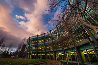 Fast-moving clouds from an approaching weather system move over UAA's Consortium Library.