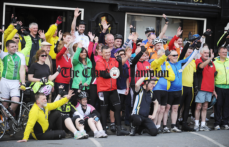 Posing for a photograph at the stop-over in Kilrush during the Clare 250 Cycle at the weekend. Photograph by Declan Monaghan