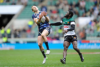 Byron McGuigan of Scotland catches the ball as Wensley Mbanje of Zimbabwe hassles during the iRB Marriott London Sevens at Twickenham on Saturday 11th May 2013 (Photo by Rob Munro)