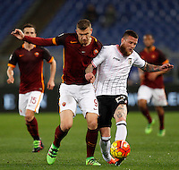 Calcio, Serie A:  Roma vs Palermo. Roma, stadio Olimpico, 21 febbraio 2016. <br /> Roma's Edin Dzeko, left, and Palermo's Michel Morganella fight for the ball during the Italian Serie A football match between Roma and Palermo at Rome's Olympic stadium, 21 February 2016.<br /> UPDATE IMAGES PRESS/Riccardo De Luca