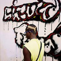 An aspirant Kuduru/Kuduro musician outside a recording studio in Sambizanga musseque (slum) shows off his hair cut. ..