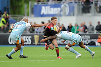 20130512 Copyright onEdition 2013©.Free for editorial use image, please credit: onEdition..Owen Farrell of Saracens is tackled by Soane Tonga'uiha (left) and Courtney Lawes of Northampton Saints during the Premiership Rugby semi final match between Saracens and Northampton Saints at Allianz Park on Sunday 12th May 2013 (Photo by Rob Munro)..For press contacts contact: Sam Feasey at brandRapport on M: +44 (0)7717 757114 E: SFeasey@brand-rapport.com..If you require a higher resolution image or you have any other onEdition photographic enquiries, please contact onEdition on 0845 900 2 900 or email info@onEdition.com.This image is copyright onEdition 2013©..This image has been supplied by onEdition and must be credited onEdition. The author is asserting his full Moral rights in relation to the publication of this image. Rights for onward transmission of any image or file is not granted or implied. Changing or deleting Copyright information is illegal as specified in the Copyright, Design and Patents Act 1988. If you are in any way unsure of your right to publish this image please contact onEdition on 0845 900 2 900 or email info@onEdition.com